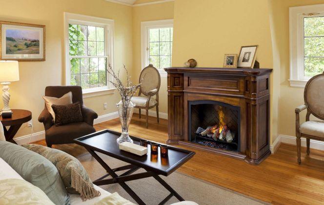 Cette cheminée électrique au design ancestral apportera une ambiance cosy dans votre salon. © Faber