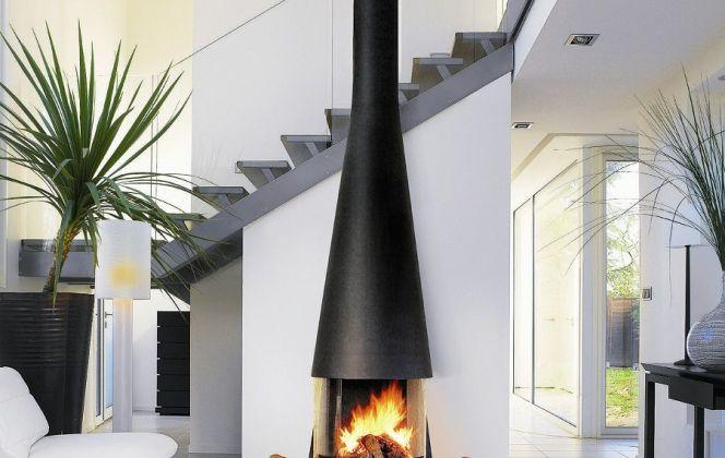 Cette cheminée aux lignes et formes harmonieuses viendra embellir et réchauffer comme il se doit votre pièce à vivre. © Focus Création