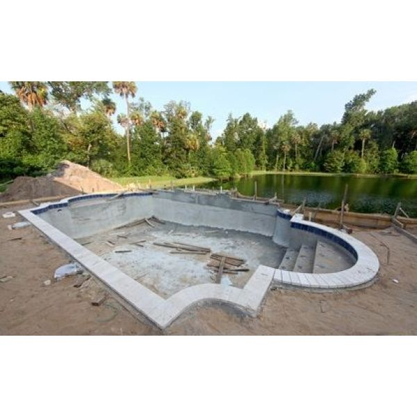 Construction d 39 une piscine conseils travaux for Regle construction piscine