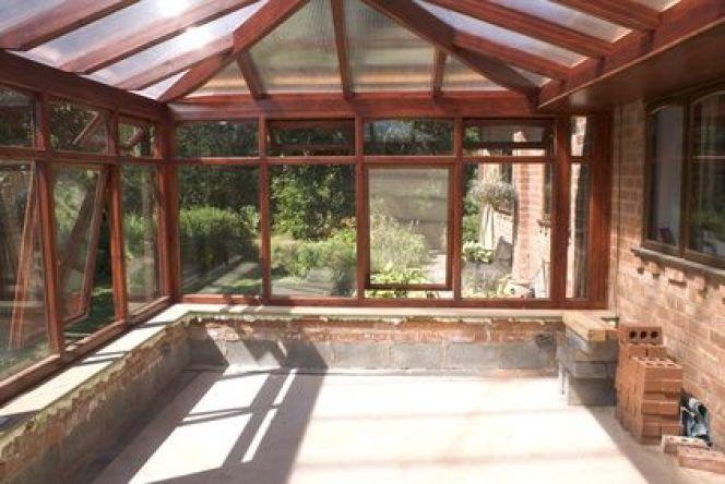 poele a bois pour veranda une vranda sur une terrasse en. Black Bedroom Furniture Sets. Home Design Ideas