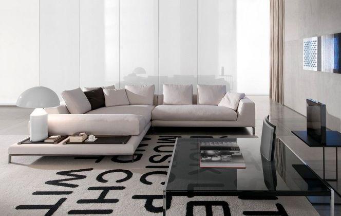 Ce salon haut de gamme aux teintes noires et blanches apportera une touche de sérénité dans votre maison. © Minotti